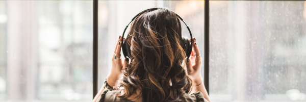A girl is listening to music