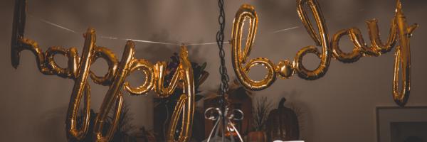 Balloons spelling happy birthday